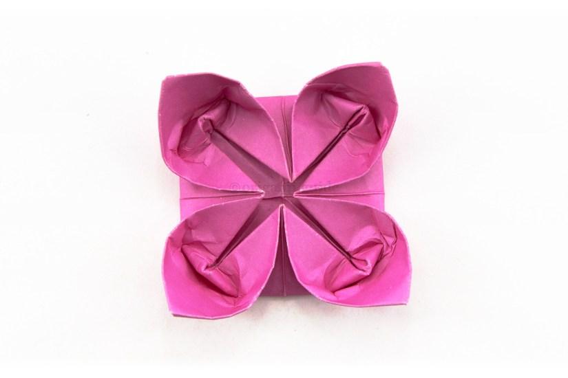 20. Fold the little inner flaps up inside the flower.