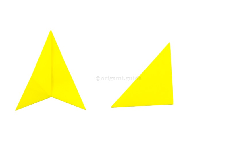 9. Fold the right point over to the left point. You may want to stick the flaps of the triangle together.