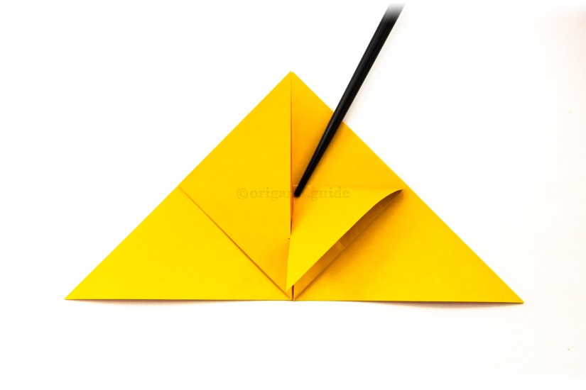 15. Take the top left point and bring it down to the bottom edge, make a small pinch to mark the middle point.