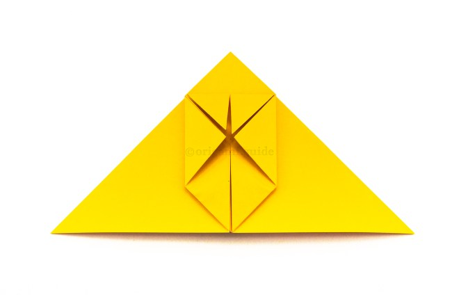 18. Fold the top left and right points down to align with the middle point.