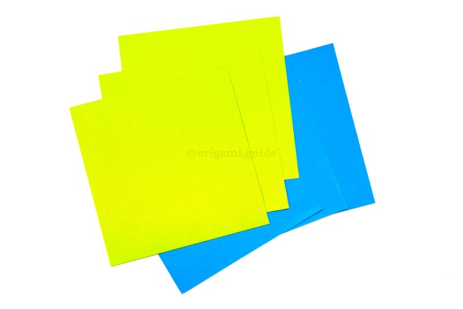 1. Get 6 sheets of square paper, they can be any size. Here we have paper that is 7.5 x 7.5 cm