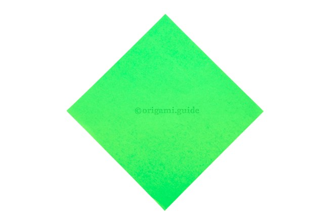 1. This is the front of the origami paper, our arrow will end up being this colour.