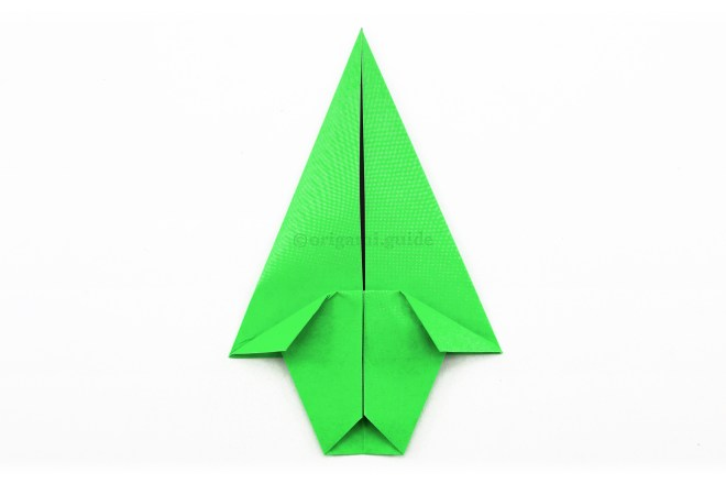 12. Fold the top left and right corners of the front section diagonally inwards.