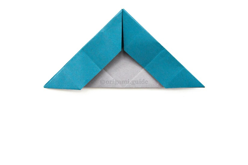 23. Fold the bottom point up the top point.