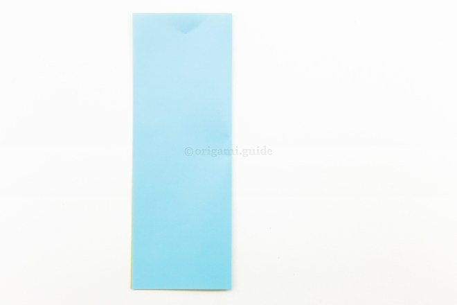 3. Fold the right edge of the paper over to the left side.