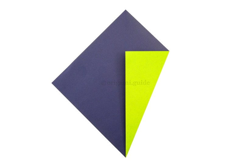 5. Take the bottom right diagonal edge and fold it to align with the central vertical crease.