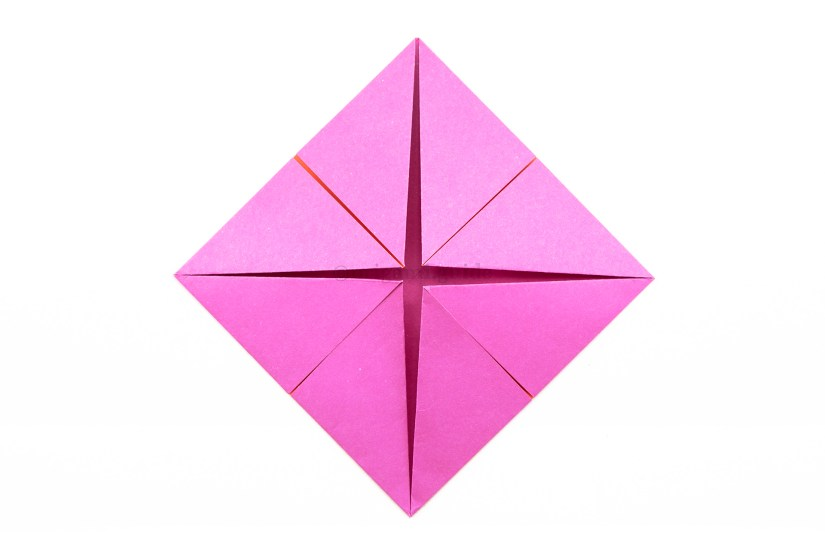 10. Fold the rest of the corners to the middle as well.