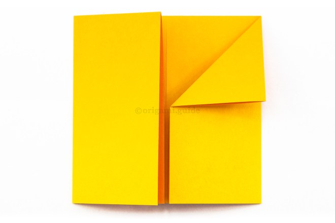 8. Fold the top left point of the right section diagonally down to the right.