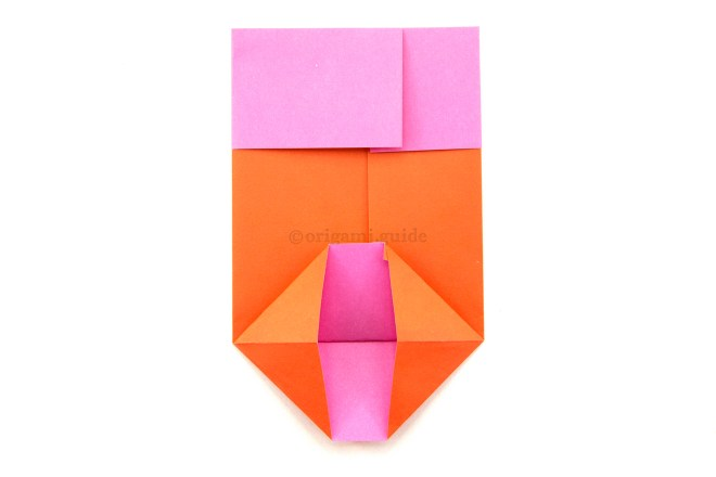 11. Open out the bottom section, squash folding the two sides into triangles.