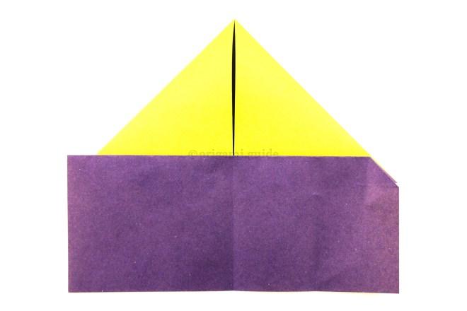 11. Reverse fold the previous crease inside.