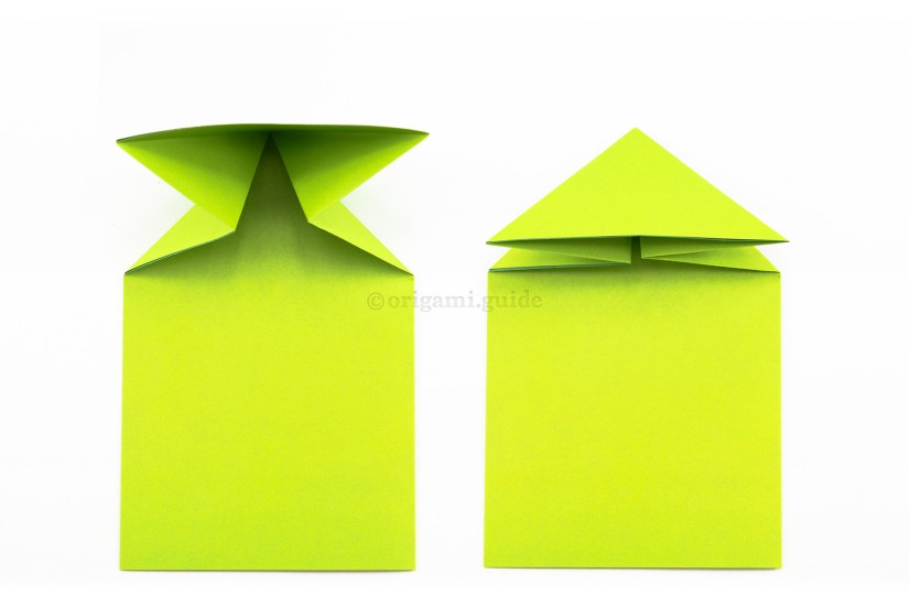 12. Bring the top left and right edges forward and down, flattening the paper into a triangle shape.