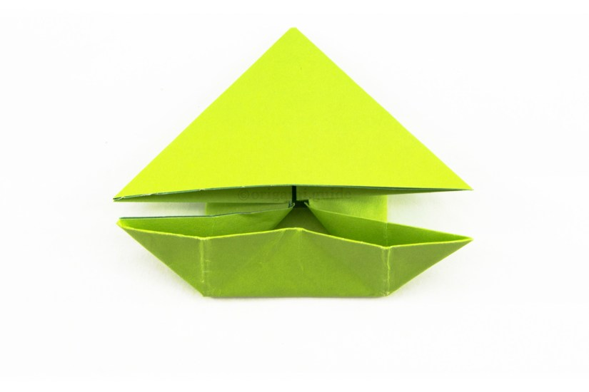19. Bring the inner corners of the lower section up and outwards to create a boat shaped flap.