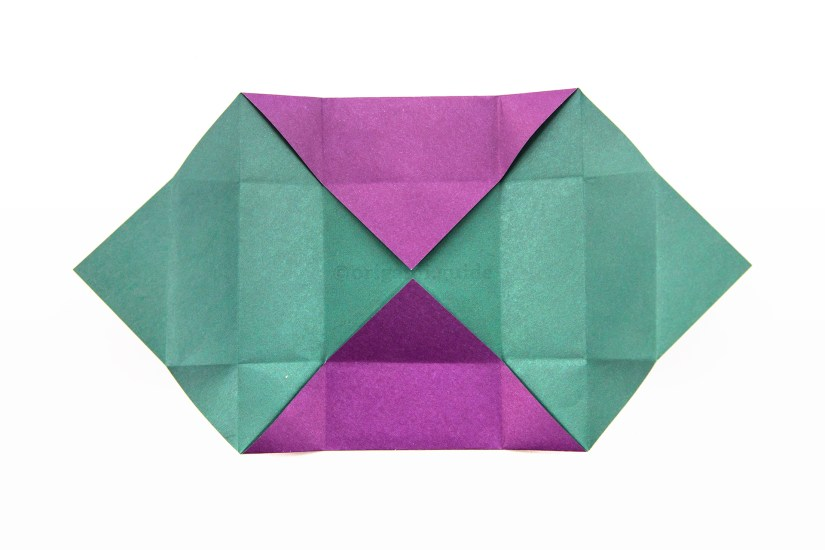 16. Unfold the left and right sections completely.