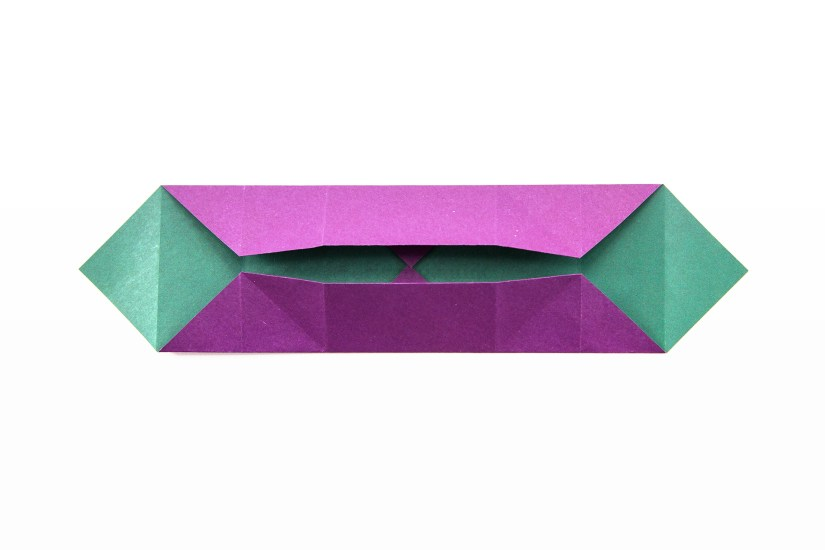 17. Fold the top and bottom edges in to the middle, using the creases that already exist.