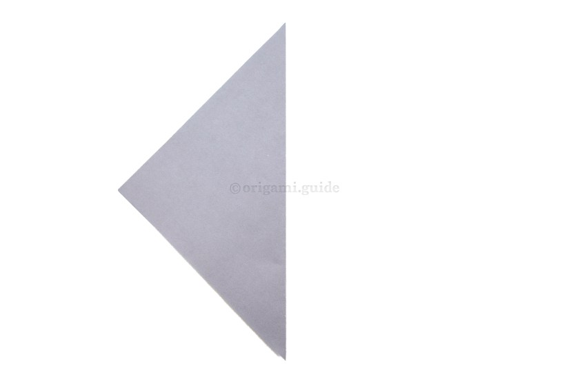 3. Fold the right point over to the left point creating a central vertical crease.