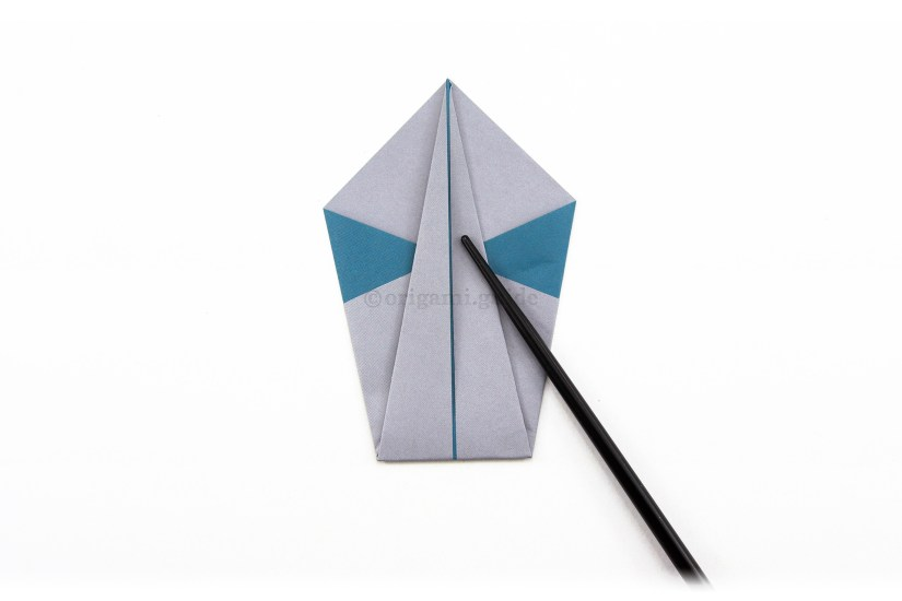 8. Fold the bottom point up to the top point.