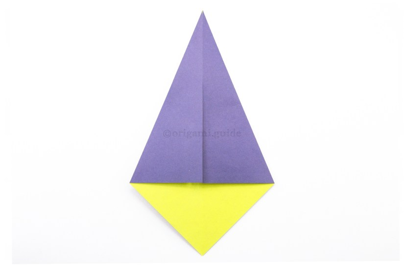 6. Fold the top left diagonal edge to align with the central vertical crease.