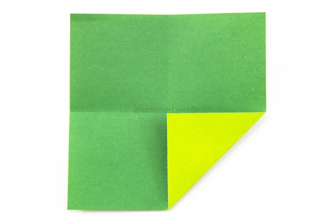 6. Fold one corner to the center of the paper.