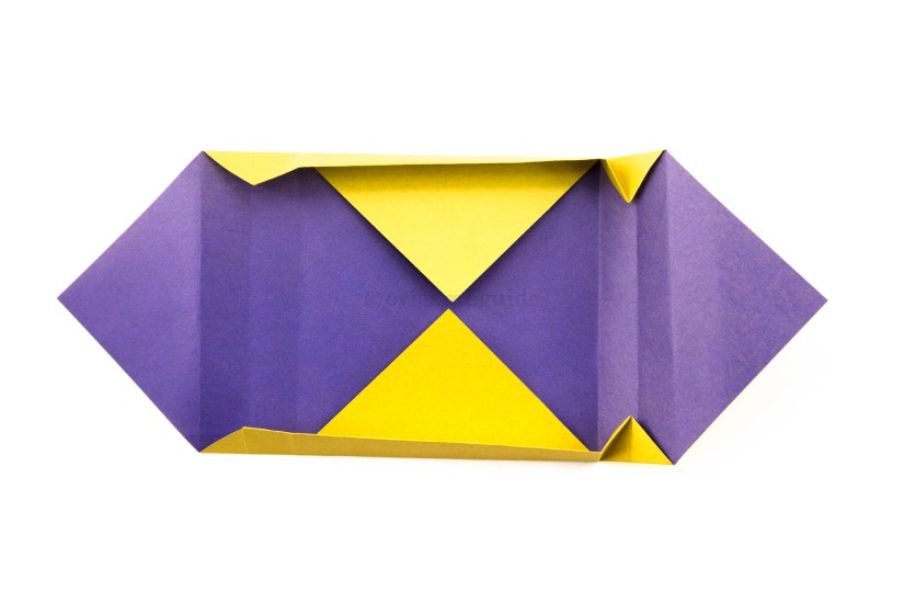 17. Open out the top and bottom edges to become a box, at the same time, lift the right section.