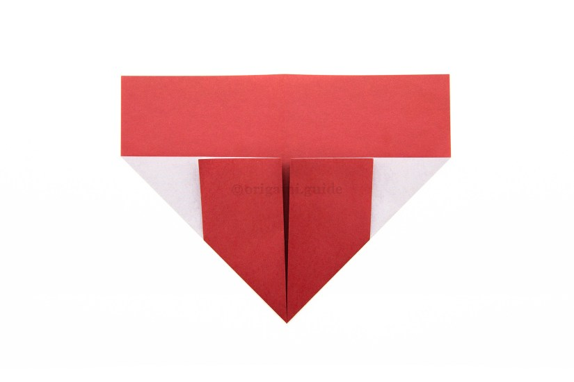 10. Fold the bottom left corner diagonally up to the right, aligning it with the vertical crease.