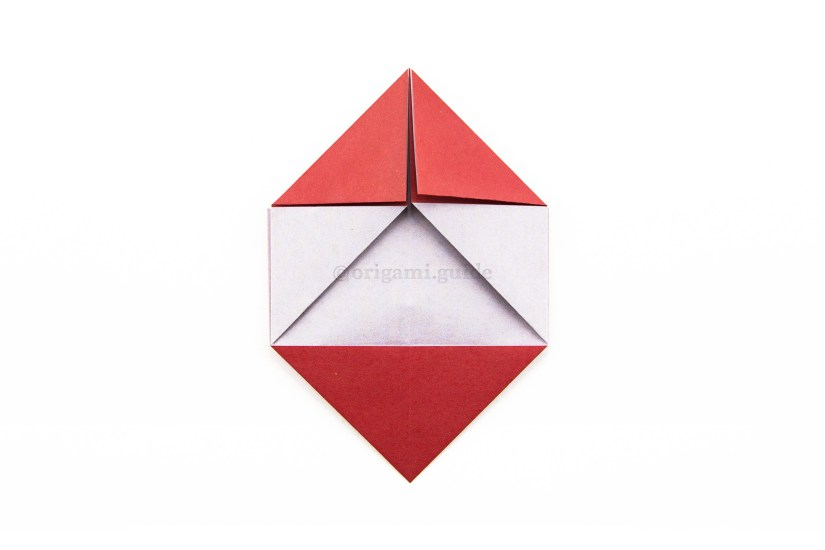 13. Fold the top left and right corners diagonally inwards.