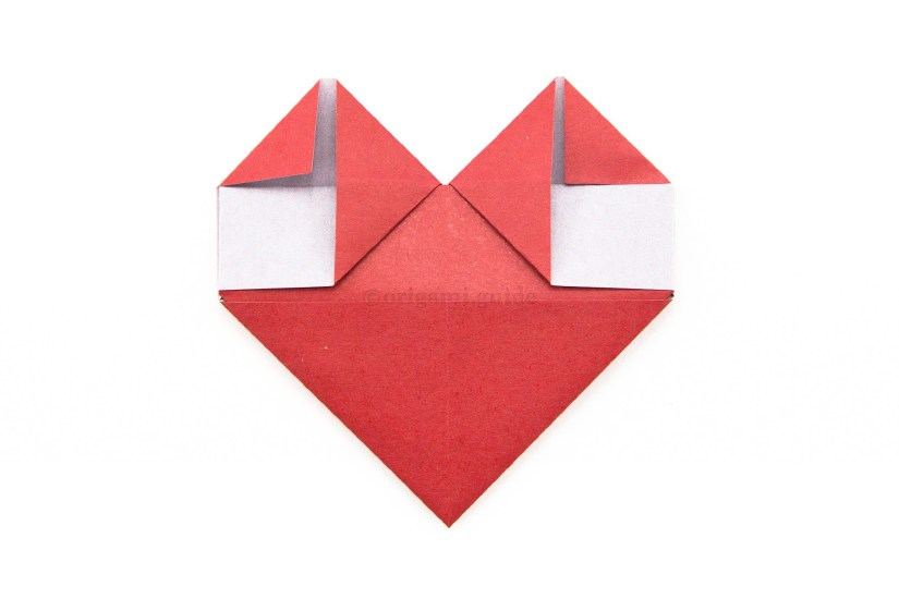 18. Fold the top left and right corners diagonally inwards.