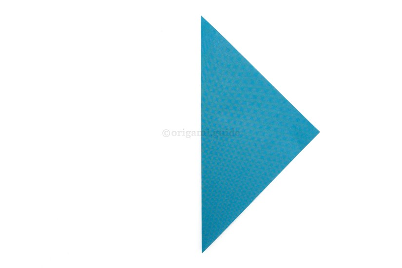 3. Fold the left point over to the right point.