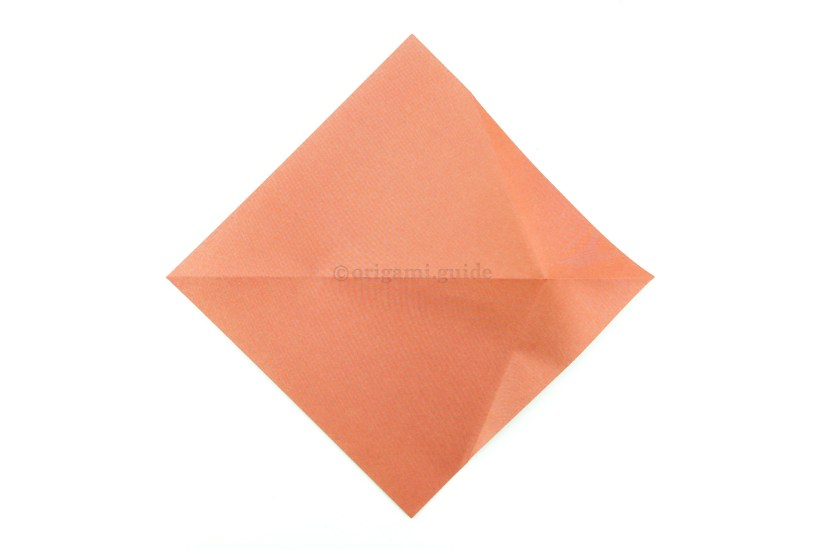 6. Flip the paper over to the other side, from top to bottom.