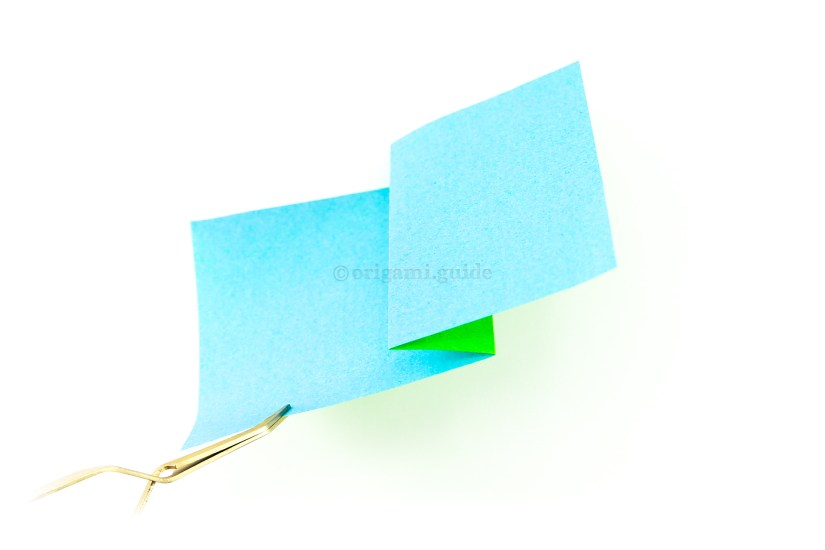 4. If you pick up the paper, you'll be able to see the 'pleat'.