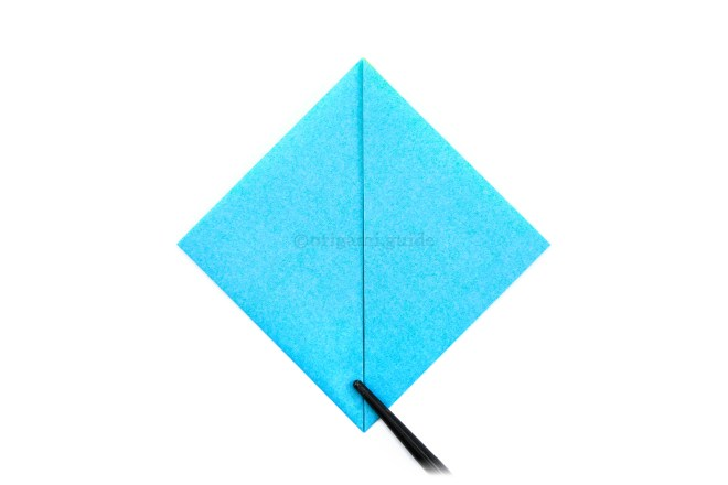 6. Fold the bottom left and right points diagonally down to the bottom point.