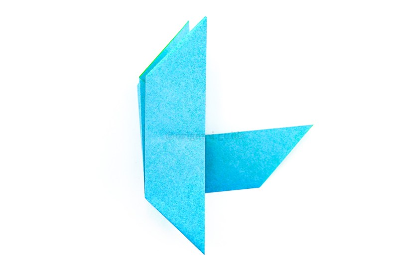 18. Flip the paper over to the other side, from left to right.