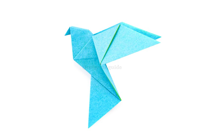 31. The origami dove is completed.
