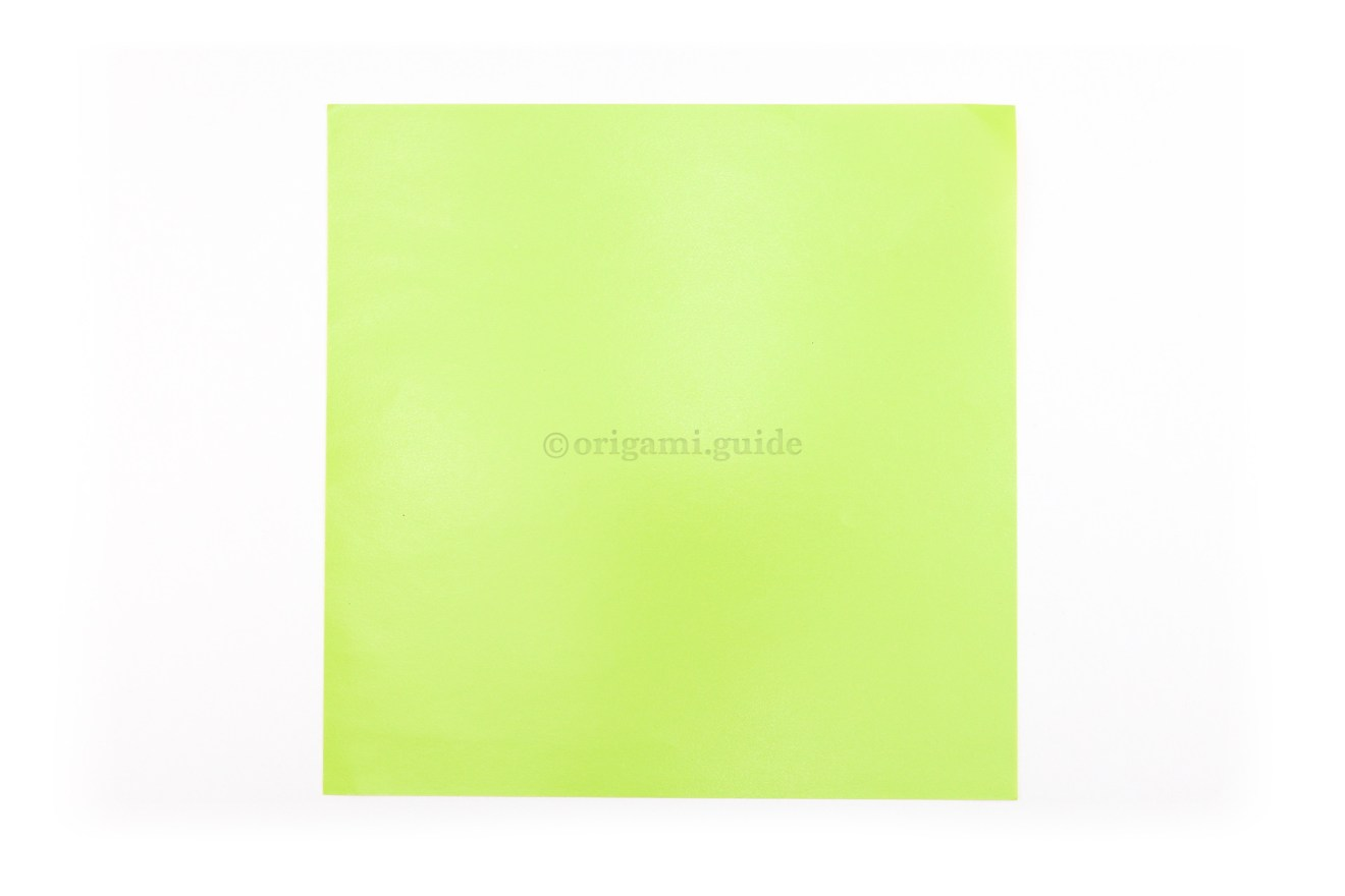 2. This is the back of our origami paper, the circular design in the middle with end up being this color.