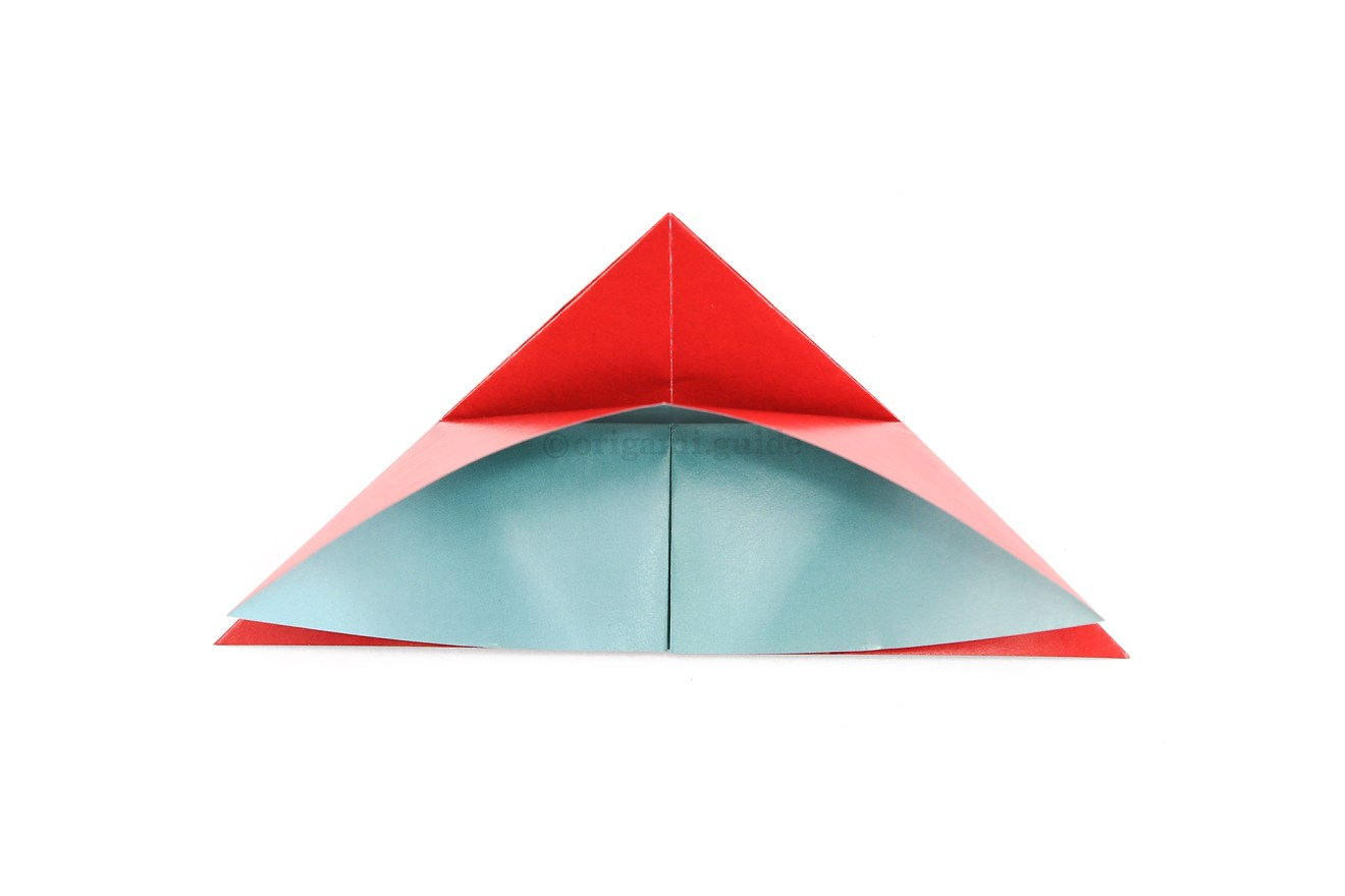 Unfold the previous step, allowing the front layer of paper to raise up to the top.