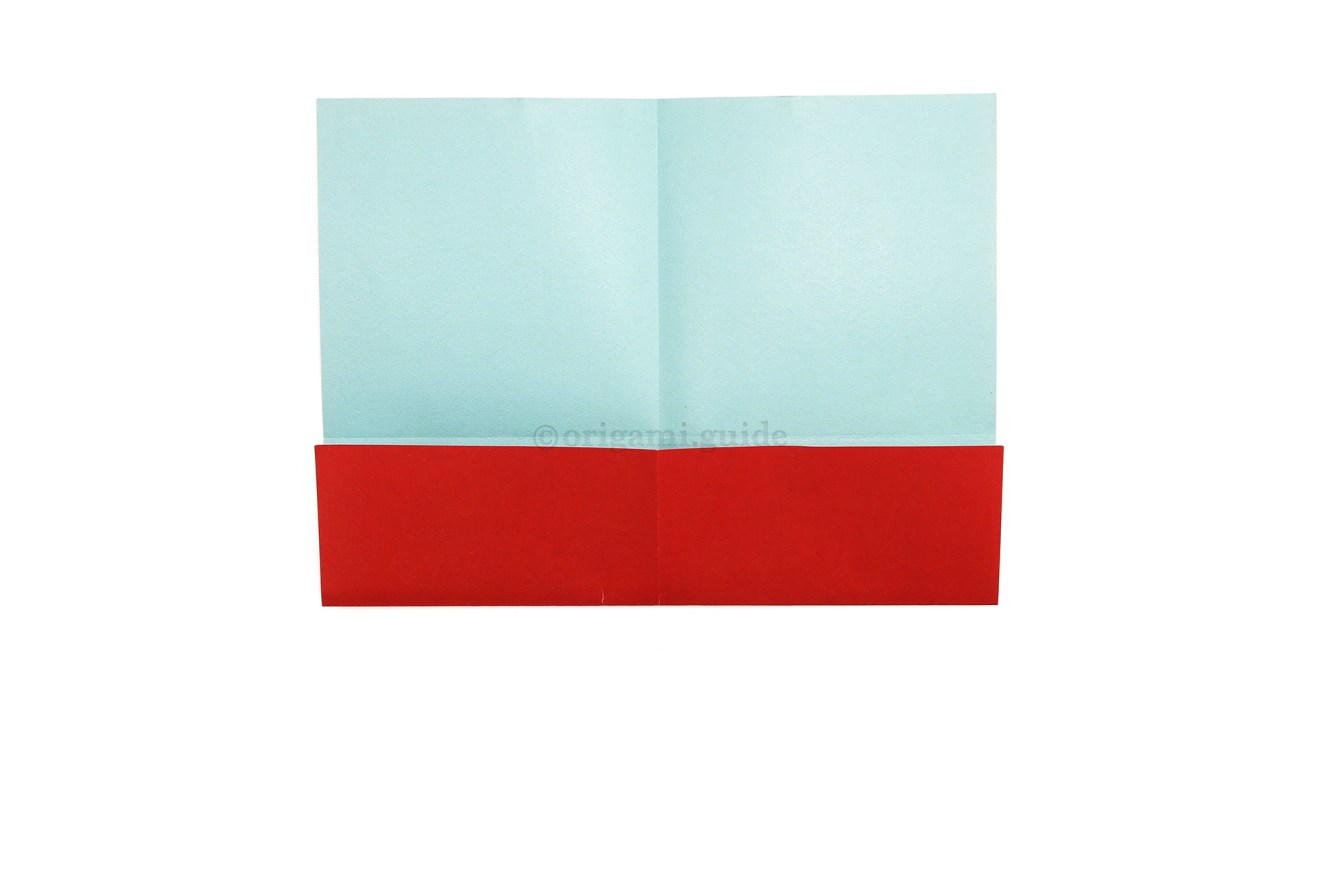 7. Fold the bottom edge up to the central horizontal crease.