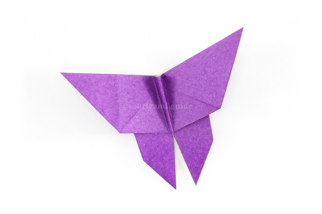 Reverse the left crease you made in step 27 and shape the wings into the desired position.