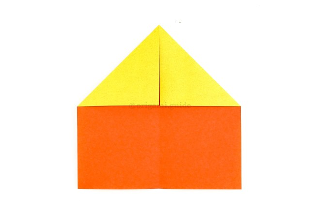 Fold the top left and right corners diagonally in to the centre.