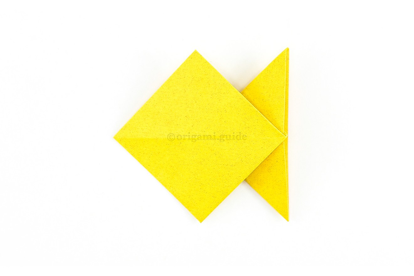 Flip the paper over to the other side, the origami fish is complete!