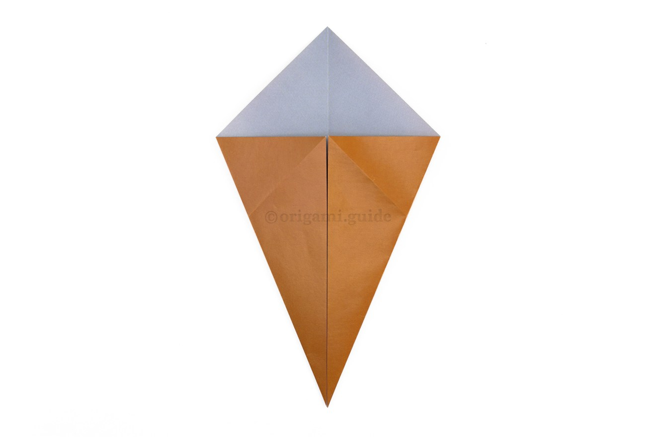 Fold the lower left and right diagonal edges to the middle.