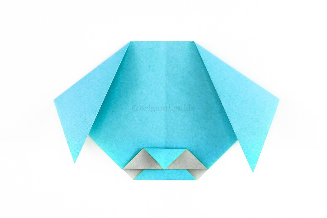 To create a chin, unfold the flap that you tucked inside and re-fold it a little lower.