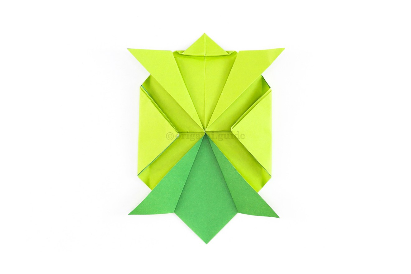 Unfold the previous step and fold the left and right points again but this time leave a small gap.