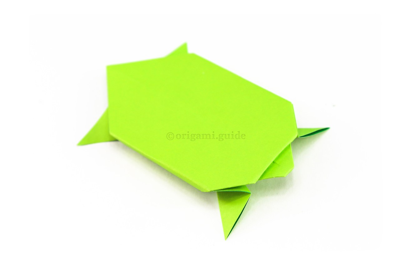 Flip the origami turtle over to the other side and adjust the legs however you like. You could draw a little face on the turtle as well.