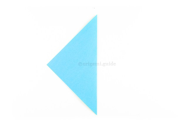 Starting with the paper rotated to a diamond, fold the right point over to the left point.