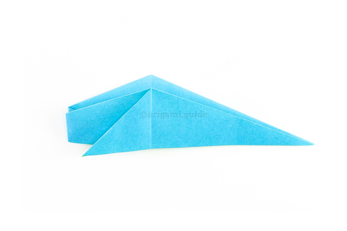 Fold the bottom section up to the top, revealing the shape of the whale.