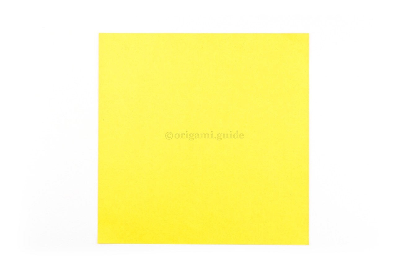 Flip the paper over to the back of the origami paper, this colour will be visible on the inside of the flower.