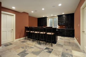 Basement Kitchen / Wet Bar Area with Seating, Egress Window and Oversized Slate Tile Floor