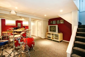 Basement Remodel with Music Room, Red Painted Walls and Central Beam and Posts