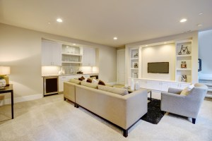Basement Living Room for entertaining with Large Egress Window, Wet Bar and TV in lighter shades of grey