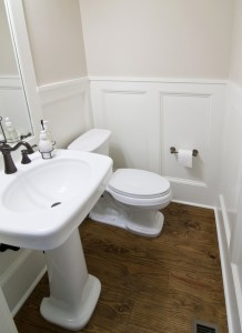 Powder Room Remodel with Stained Oak Flooring and Painted Board and Batten Wainscot