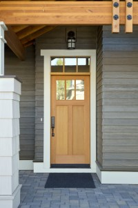 Exterior Remodel of Home with Painted Grey Siding, Painted White Trim and Stained Wood Craftsman Style Front Door